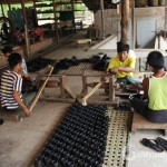 Artisans in a lacquer ware workshop, Bagan