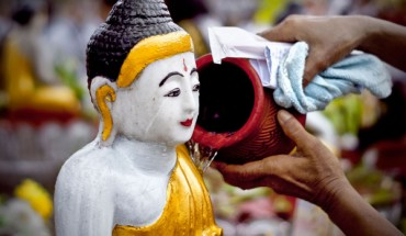 Watering Buddha image in Kason Festival