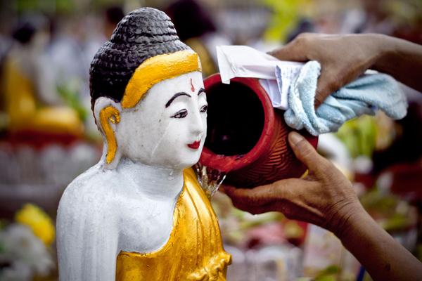 Watering Buddha image in Kason Festival