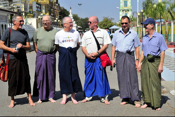 Tourists try to wear Longyi in Myanmar