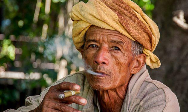 Burmese man smoking traditional handmade cigar