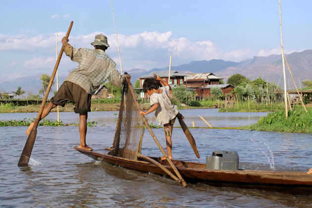 Father and his daughter fishing in Inle Lake
