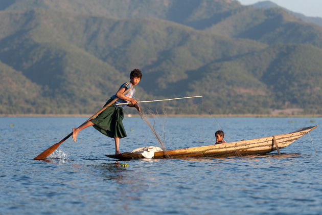 Two brothers boating along Inle Lake