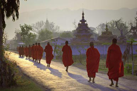 Monks begging for alms in the early morning.