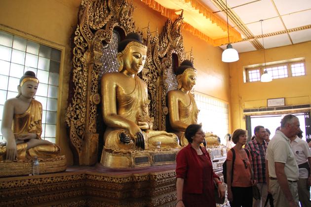 Myriads of golden Buddha image worshiped in Shwedagon