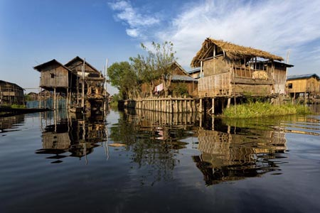 Houses built on stilts in the village of Nampan on the edge of Inle Lake, Myanmar.