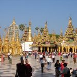 Shwedagon Pagoda in a crowded day.