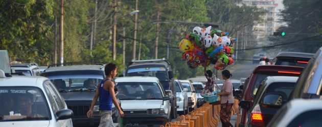 Traffic Jam in Yangon and the locals crossing the road by over the fence