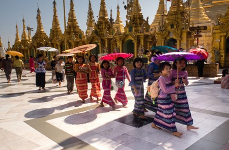 Small children remove their footwears when visiting Shwedagon Pagoda