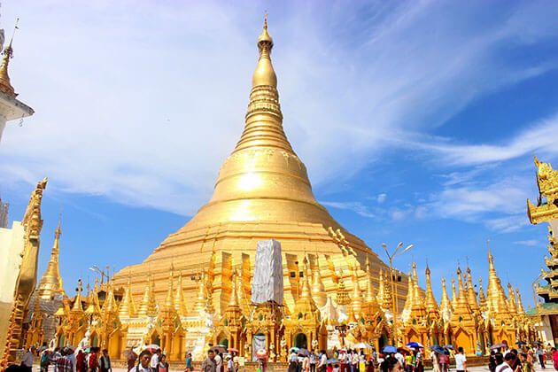 shwedagon pagoda glittering its light on a sunny day