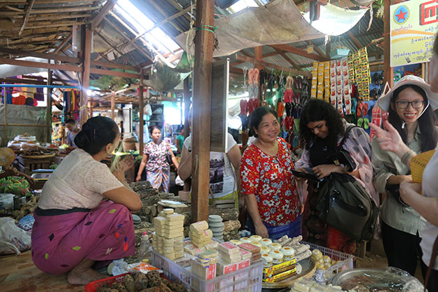 talk with the local in nyaung u market - worth trying experience in myanmar tour