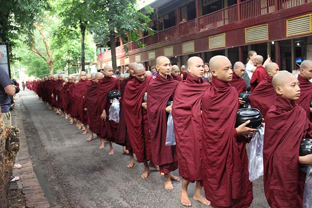 the monks at Mahagandayon Monastery ask for alms in the morningthe monks at Mahagandayon Monastery ask for alms in the morning