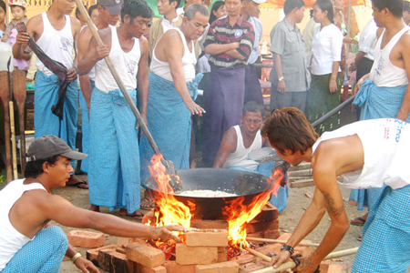 People cooking rice in Htamane Sticky Rice Festival.