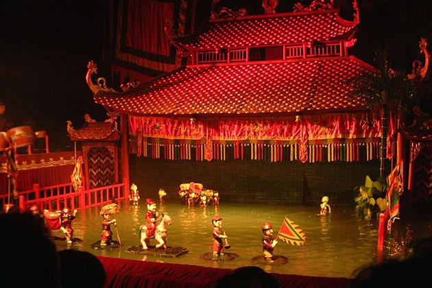 enjoy water puppet show in Hanoi-Myanmar laos vietnam tour