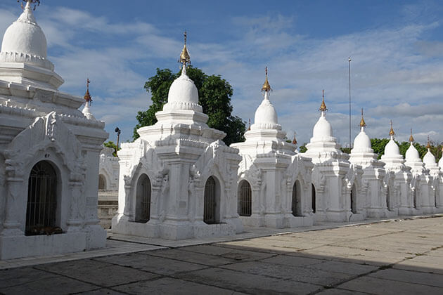 Kuthodaw pagoda and the largesrt Buddhist book carved on 729 marble slabs