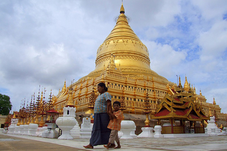 The spire of Shwezigon Pagoda is covered by pure gold leaf