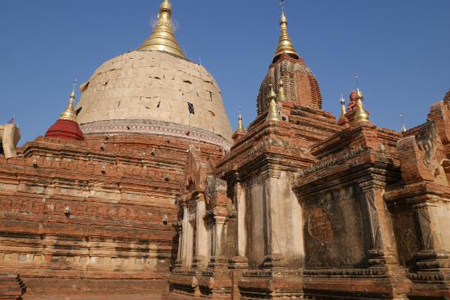 The Dhamma Yarzika is a squat, conical spire like the Shwezigon.
