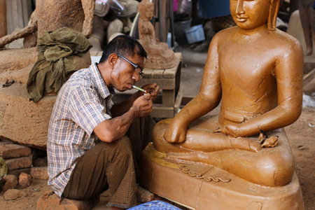 A wax carver at a bronze casting studio, Myanmar