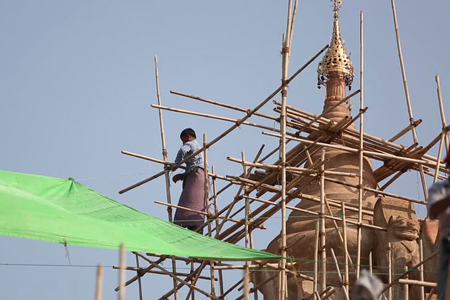 Burmese men working at the temple construction site