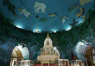 Hall inside Maha Wizaya pagoda with wall painting of night sky w