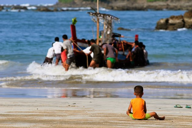 Local child playing and waiting his father come back from the sea trip in Maung Shwe Lay fishing village