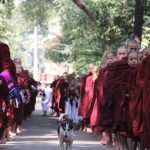 Monks in queue, morning ceremony in Mahagandaryone Monastery