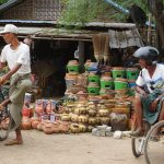 Two men with their bike in a short break before loading goods in Nyaung Market