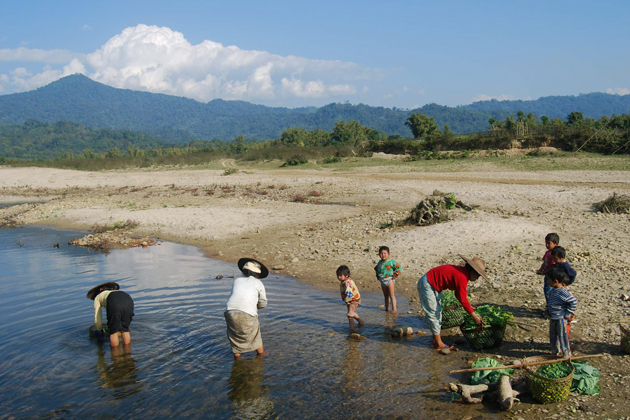Villagers wash vegetables in a stream near Kaung Mu Lon village, near Putao