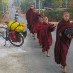 Little monks walking downtown for alms giving, Ywa Ngan