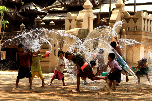 Local children playing around with water in Thingyan festival