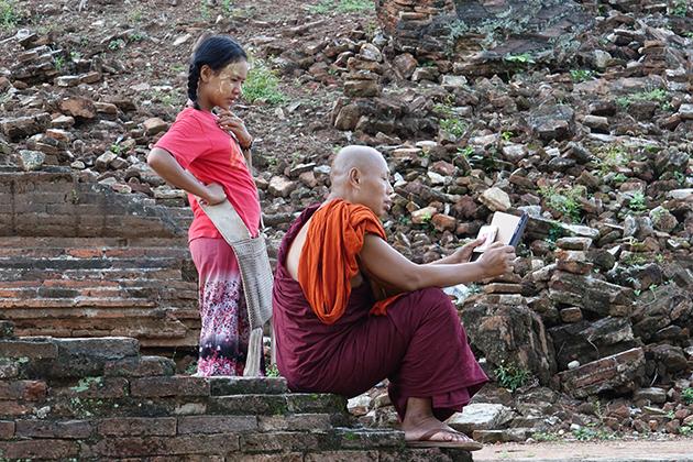 A Monk and a girl reading book at Mingun pagoda
