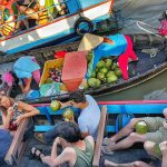tourists on cai rang floating market