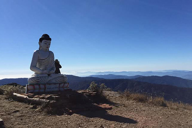 the Buddha statue on the top of Nat Ma Taung