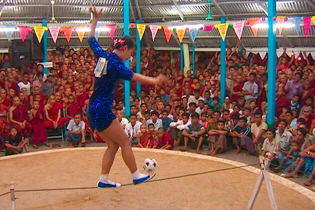 an athlete playing chinlone sport on the string