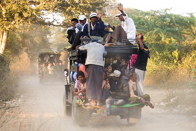A loaded truck on dusty road in Bagan
