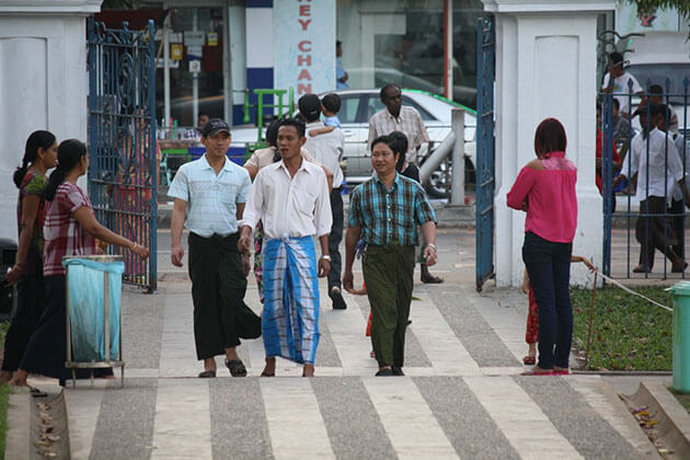 Burmese men wearing longyi - a type of skirt wrapped around the waist