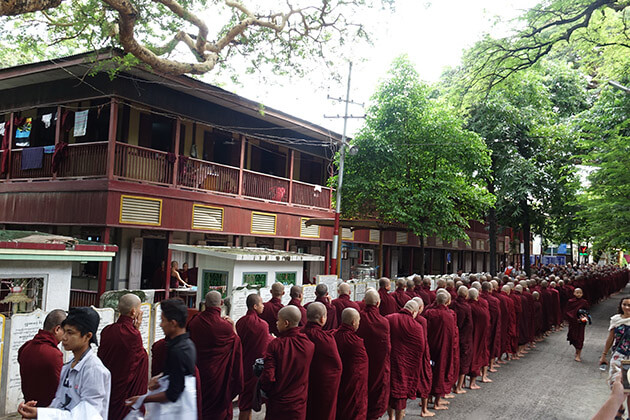 monks in a morning alms at Mahagandayone monastery
