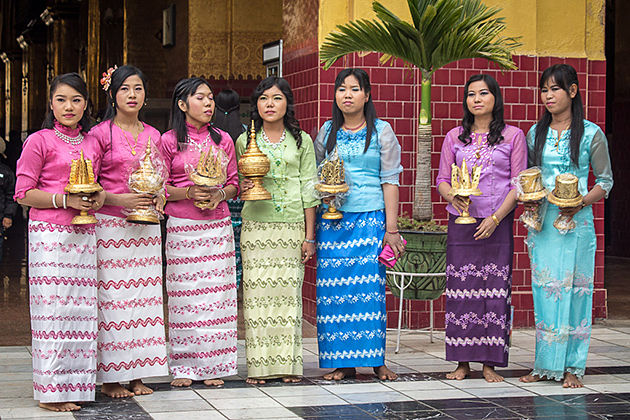 Burmese women wearing longyi-the traditional dress of Myanmar