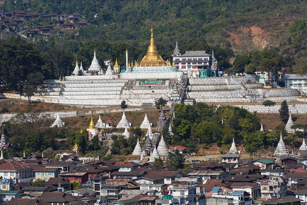 behold a gilded temple in Mogok at a far distance