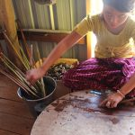 the local artisan is extracting lotus to make lotus silk