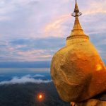 the massive golden rock is where people gather to pay homage