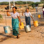 women take water to their home in bagan village