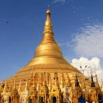 Shwedagon pagoda glittering its golden hue in the sky - yangon tour packages