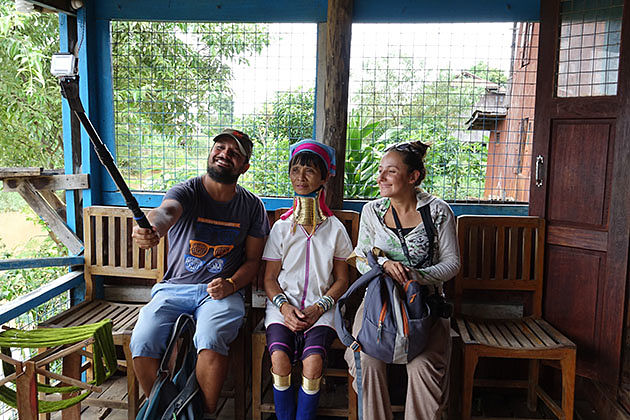 Tourist taking photo with the long neck woman in Kayah