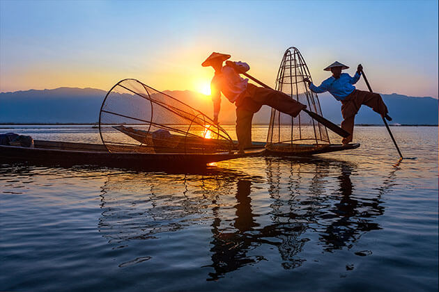 Inle lake scenery and leg rowing fishermen