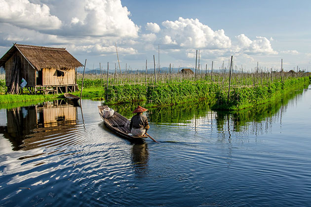 a man working on his floating garden