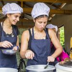 tourists learn how to cook the traditional dish of Intha people