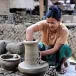 local woman making a clay pot in Yandaboo village