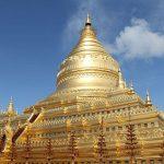 Shwezigon golden stupa glittering in the sunlight