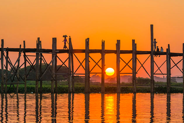 Watch the sunset on U Bein Bridge is a not to miss experience in Mandalay